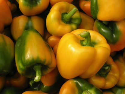 bunch of yellow bell peppers