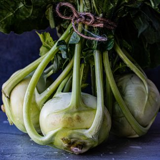 green vegetable on blue wooden table