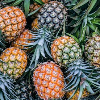 orange and green pineapple fruits